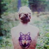 Аватар девушка с тату в виде волка на спине