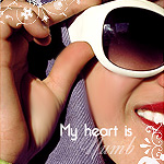 Аватар Девушка в белых очках ('My heart is numb' / 'Моё сердце одеревенело')