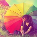 Аватар Девушка сидит под радужным зонтом