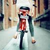 Аватар Девушка едет на велосипеде по городу