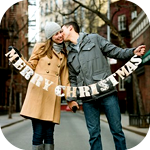 99px.ru аватар Пара целуется, держа в руках буквы, из которых получилось поздравление *Merry Christmas*