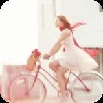 Аватар Девушка едет на велосипеде, с прикреплённой к нему корзинкой с цветами