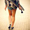 Аватар Девушка несет в руке скейт