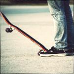 Аватар Парень стоит на дороге около скейта