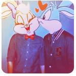 Аватар Парень целует девушку, у которых головы кроликов