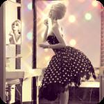 Аватар Zahia Dehar / Захия Дехар в пышном винтажном платье стоит у зеркала и красит губы