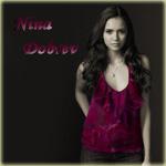Аватар Нина Добрев стоит в бардовой кофточке и прячет правую руку за спиной (Nina Dobrev)