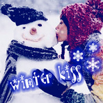 Аватар Девушка в красной шапке усыпанной снегом целует снеговика в синей шапке и шарфе (Winter kiss)