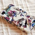Аватар Мобильный телефон с красочно разрисованной пёстрыми цветами и птицами белой панелью