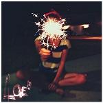 Аватар Девушка сидит на земле и держит фейерверк (Love / Любовь)