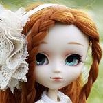 Аватар Кукольное личико с голубыми глазами и рыжими косами