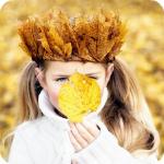 Аватар Маленькая девочка с венком из осенних листьев держит в руке желтый листок