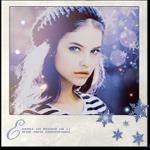Аватар Красивая девушка в вязаном берете на фоне бликов и снежинок