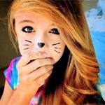 Аватар Милая девочка с подрисованными тушью кошачьими усиками и носом закрыла рот рукой