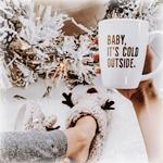Аватар Парень в тапках с оленьими мордочками держит в руке кружку с надписью (Baby its cold outside)