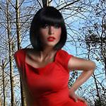 Аватар Брюнетка в красном платье на фоне деревьев голубого неба