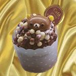 99px.ru аватар Японский шоколадный десерт с бурым медвежонком, шоколадными шариками и медалью с логотипом кафе