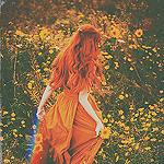 99px.ru аватар Рыжеволосая девушка среди желтых цветов