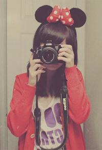 Обои Девушка с ушками Микки Мауса держит в руках фотоаппарат