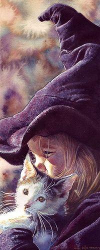 Аватар вконтакте Девочка в колпаке колдуньи держит на руках кошку