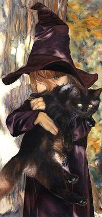 Аватар вконтакте Девочка в одеждах колдуньи держит на руках черную кошку