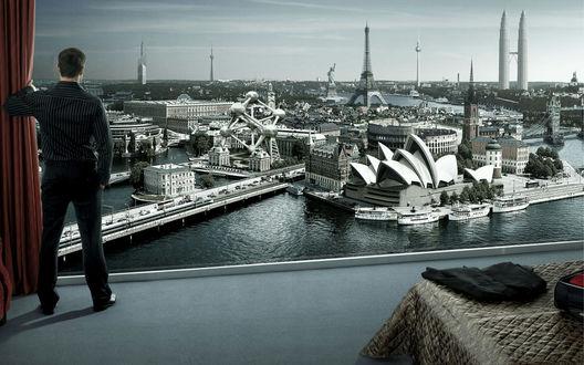 Обои Вид из окна (Мужчина стоит у окна из которого открывается потрясающий вид на все памятники архитектуры: Эйфелева башня, Сиднейский оперный театр, статую свободы, Тауэрский мост и прочие)