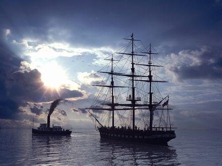 Обои Парусная яхта плывет вслед за баржей, сквозь облака пробивается солнце