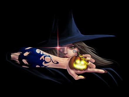 Обои Ведьма с горящей тыквой в руке