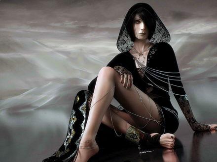 Обои Девушка, облаченная в черные одежды, сидит на земле