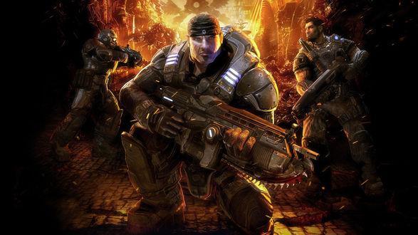 Обои Маркус Феникс / Marcus Fenix на фоне огня с автоматом в руках, главный персонаж из игры Gears of War / Шестерни войны