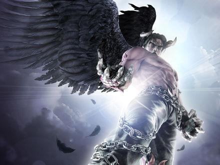 Обои Парень обмотанный цепями с вороньими крыльями