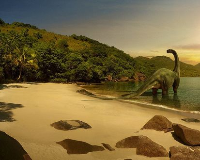 Обои Динозавр загорает на берегу моря