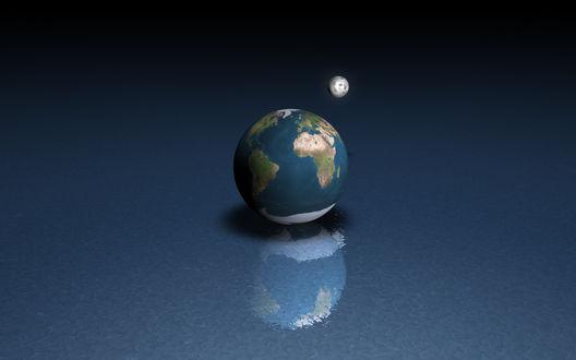 Обои Земля на шершавой поверхности, рядом луна