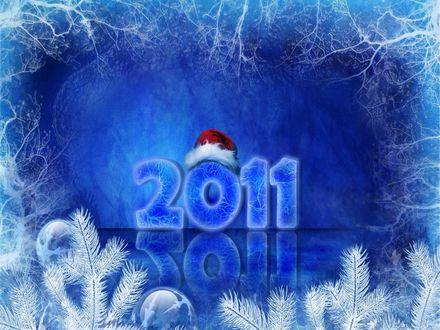Обои На надписи 2011 лежит шапка Деда Мороза
