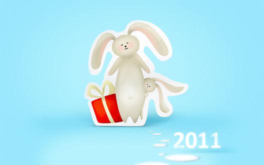 Обои Кролики с новогодним подарком и надпись 2011
