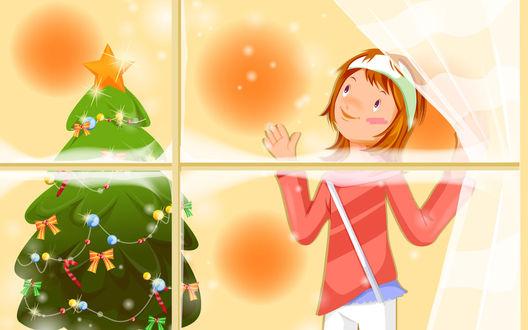 Обои Девочка смотрит в окно на падающий снег, а дома у нее нарядная елка