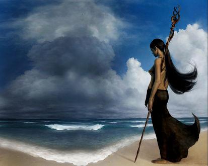 Обои Девушка на берегу неспокойного моря с посохом