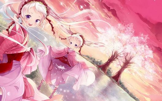 Обои Девочки-близняшки резвятся у реки во времени цветения сакуры