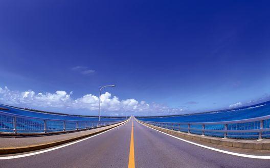 Обои Красивый ракурс съёмки моста через реку... Складывается впечатление,что дорога уходит прямо в облака...