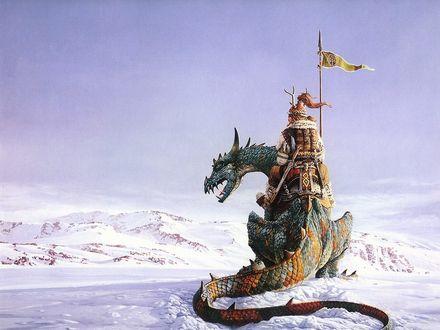 Обои Воинствующий всадник верхом на драконе всматривается в заснеженую гористую местность...