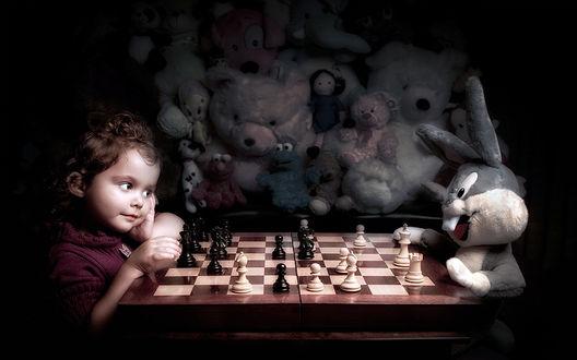 Обои Девочка играет в шахматы с зайцем, за поединком наблюдают все игрушки