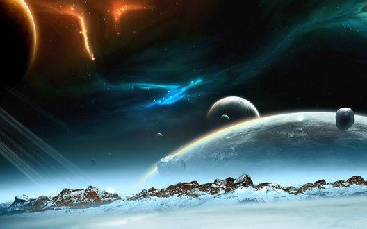 Обои Со снежной планеты с горами видны все соседние планеты