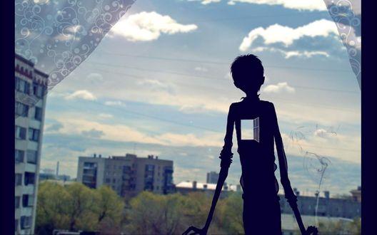 Обои Силуэт парня с открытым окном в сердце на фоне городских новостроек