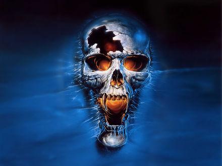 Обои Проломленный череп монстра со светящимся огнём внутри...