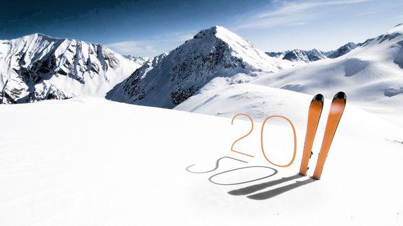 Обои Снежные горы и забытая пара лыж... 2011 год