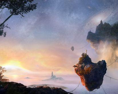 Обои Отколовшиеся каменные глыбы плавают в воздухе
