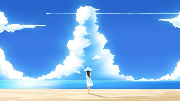 Обои Девушка стоит на пляже и смотрит на пролетающий самолёт оставивший след в небе