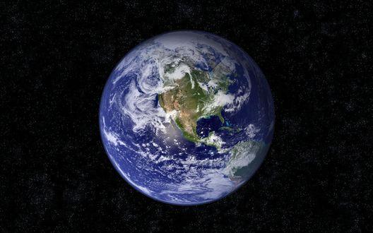 Обои Планета Земля среди множества маленьких звездочек