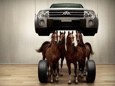 Обои Четыре лошади под капотом Митсубиси / Mitsubishi
