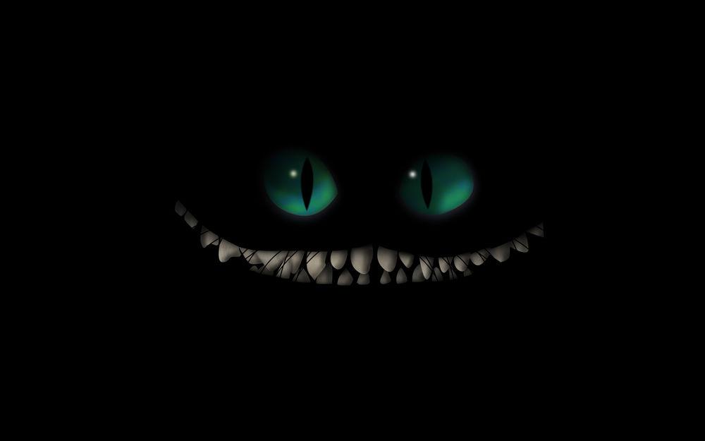 Чеширский кот на чёрном фоне